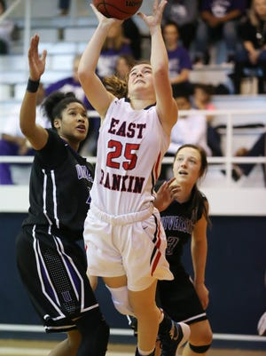 East Rankin's Mackenzie Thompson (25) scores two of her game-high 31 points around University Academy's Rejayla Williams in the second half of the MAIS AAAA, Division II girls championship game. University won 56-54.