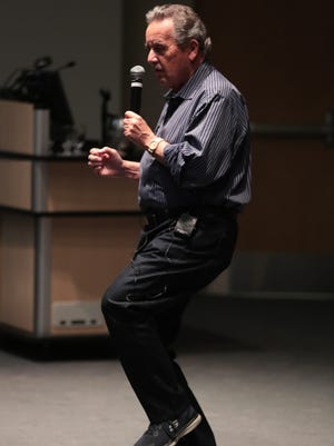 Manny Sepulveda shows off his dance moves while sharing a story at the Coachella Valley Storytellers March event, March 19, 2018.