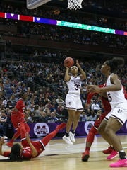 Mississippi State's Victoria Vivians (35) releases a shot in overtime. Mississippi State played Louisville in the semifinal round of the NCAA Women's Basketball Tournament in Columbus, Ohio, on Friday, March 30, 2018. Photo by Keith Warren