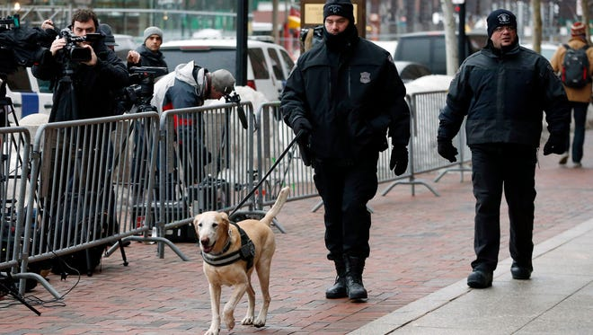 Boston Police officers patrol outside federal court on  March 5, 2015, in Boston.