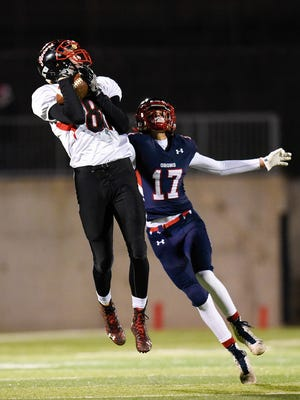 Rocori wide receiver Derek Thompson pulls in a pass over Orono defensive back Trevor Paul and takes it in to score during the first half in the state Class 4A football playoffs Friday, Nov. 11, at Husky Stadium.