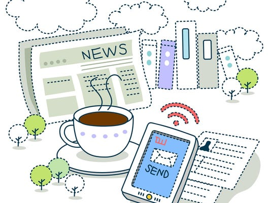 Newspaper with tea and mobile phone
