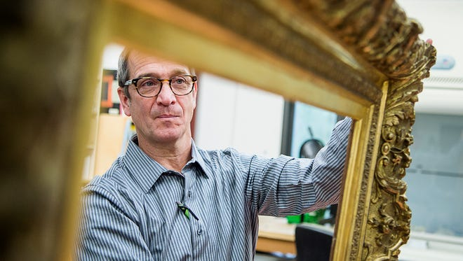 Mike Stone, a frame specialist with Biltmore's conservation team, is sleuthing out the pedigree of a gilded Barbizon frame that once housed a Monet before George Vanderbilt acquired it for a Maufra painting.