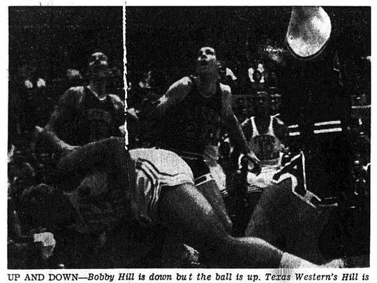 UP AND DOWN - Bobby Hill is down but the ball is up. Texas Western's Hill is shown just before going to his knees as he twists his head to see where his shot had gone. The little Miner guard had been tripped up as he tried to drive up the key for a layup. The show missed but Hill got free throws. Arizona players looking on are Dick Root (15), John Newsome (25) and bob Hansen (41). Willie Cager (10) is the TWC player in the background.