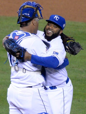 Royals starting pitcher Johnny Cueto celebrates with catcher Salvador Perez after defeating the Mets in Game 2.