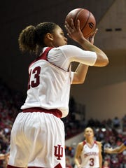 Hoosiers guard Jaelynn Penn (13) attempts a shot against TCU at Assembly Hall, March 28, 2018.