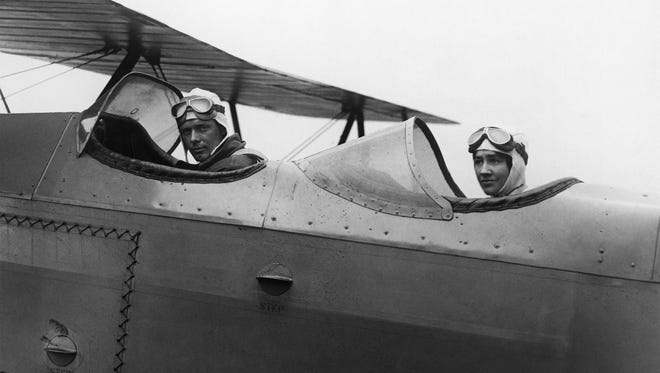 Charles Lindbergh made history flying across the Atlantic in 1927 in the  Spirit of St. Louis. Here, he is shown with Anne leaving Roosevelt Field in Long Island.  Charles and Anne Morrow Lindbergh leaving Roosevelt Field on Long Island, 1929.