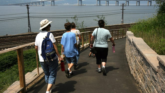 Hikers enjoy a view of the Tappan Zee Bridge on a section of the RiverWalk, which meets up with the Old Croton Aqueduct Trail, in Tarrytown.