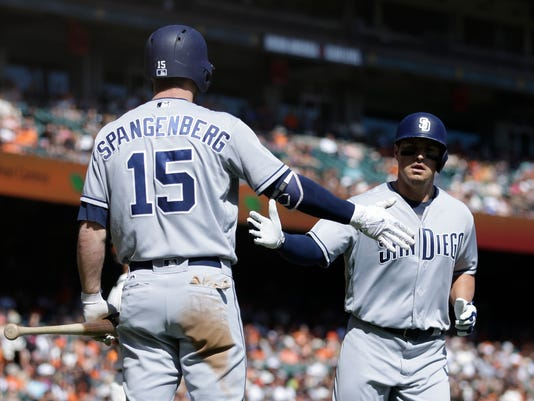 San Diego Padres' Hunter Renfroe, right, celebrates with Cory Spangenberg (15) after hitting a home run off San Francisco Giants' Johnny Cueto in the fourth inning of a baseball game Sunday, Oct. 1, 2017, in San Francisco. (AP Photo/Ben Margot)