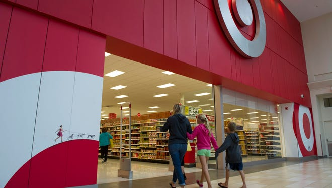 Customers walk into a Target store at Christiana Mall in Newark, Del.
