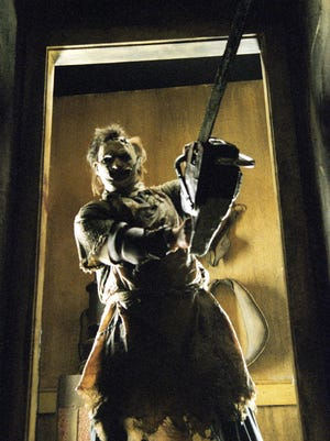 "Leatherface, played by Gunnar Hansen, takes position in a scene from the motion picture ""Texas Chainsaw Massacre."" Hansen died on Saturday at age 86."