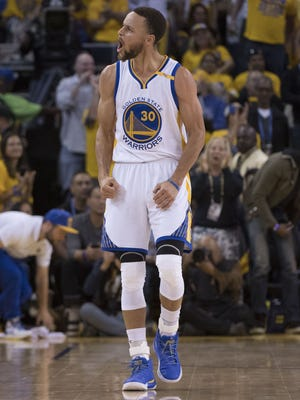 Golden State Warriors guard Stephen Curry (30) celebrates against the Portland Trail Blazers during the third quarter in game one of the first round of the 2017 NBA Playoffs at Oracle Arena.
