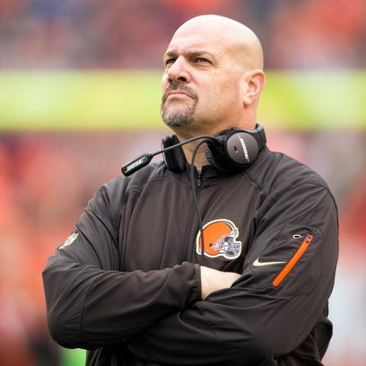 Cleveland Browns coach Mike Pettine watches the video