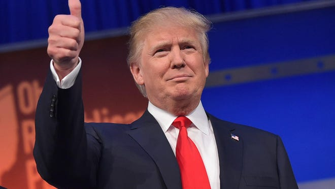 Real estate tycoon Donald Trump cracked 40 percent in a Monmouth University national GOP presidential primary poll. Here he flashes the thumbs-up as he arrives on stage for the start of the prime time Republican presidential debate on August 6, 2015, at the Quicken Loans Arena in Cleveland, Ohio. (Getty Images)