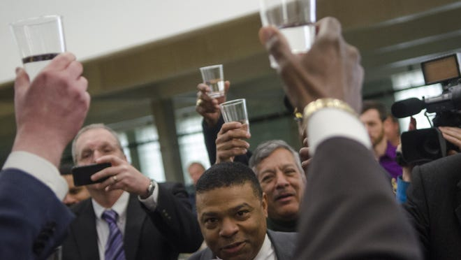 Flint city employees toast with treated water from the Flint River to celebrate the switch from Detroit water on April 25, 2014. Three years and a massive crisis later, state policies have not changed much.