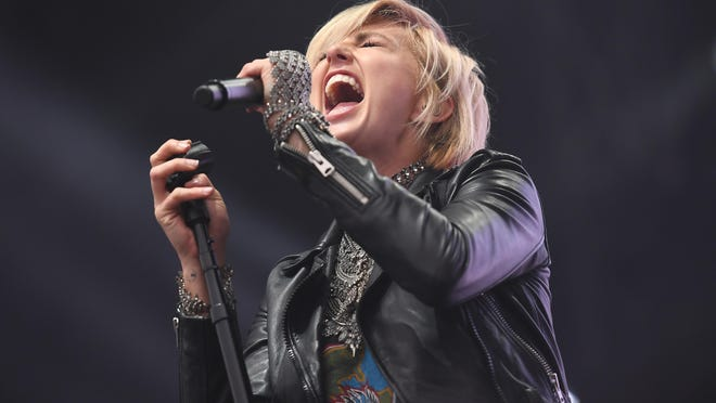 In this file photo, Sarah Barthel of Phantogram performs during 2017 Governors Ball Music Festival at Randall's Island in 2017 in New York City. Indie music artists, including Phantogram, are joining in the chorus of voices decrying police brutality on the black community.