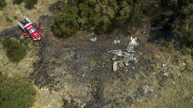 Wreckage remains after a fatal small airplane crash at RM 1431 just west of I-35 near Round Rock on Wednesday July 1, 2020.