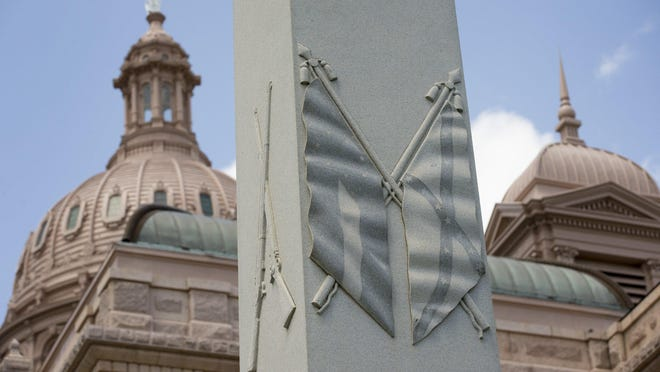 The Hood's Texas Brigade Monument, honoring soldiers who fought for the Confederacy, sits outside the Texas Capitol.