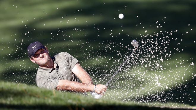 Patrick Reed hits out of the bunker on No. 10 during the third round of the Masters Tournament on Saturday. The 2018 champion holed this shot as part of a charge of birdies in the middle of his round, but two late bogeys forced him to settle for a 71.