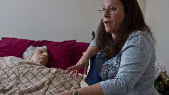 Doreen Longo of Toms River talks about the situation her mother, Lucy Schieferstein-Neri, who was bedridden with Alzheimer's and in danger of losing her Manalapan home. With help from Press on Your Side, Schieferstein-Neri stayed in their home until her death on July 4.