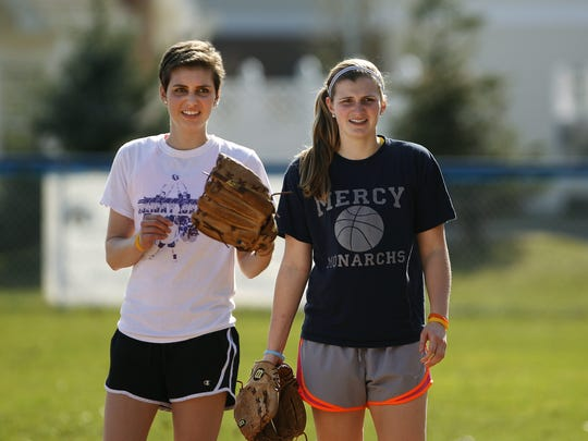 Emma Falk, left, and her younger sister, Aidan, were