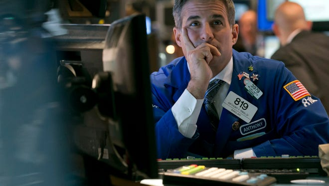 Specialist Anthony Rinaldi works on the floor of the New York Stock Exchange Monday, Sept. 29, 2014. The U.S. stock market slid to start the week, following European markets lower. (AP Photo/Richard Drew)