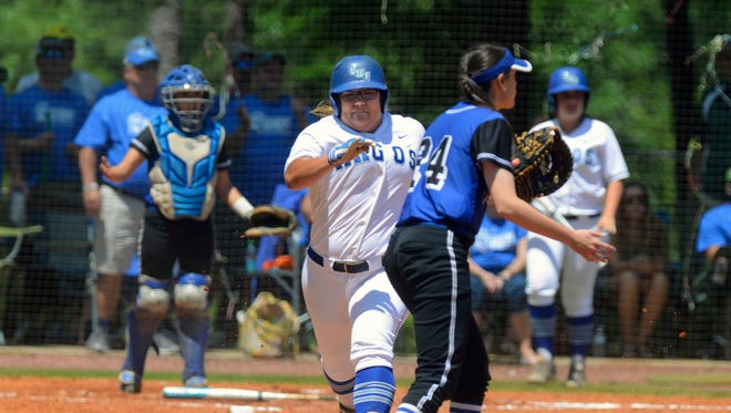 UWF's Kathleen Smiley, shown running to first in an earlier game,  smashed the 15th home run of her career and extended her lead among active players in that category, during the 14th-ranked Argos upset loss Saturday afternoon against Lee University.