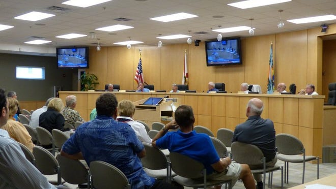 Councilors with the Marco Island City Council discuss local issues during Monday's meeting. Ashley Collins/Staff