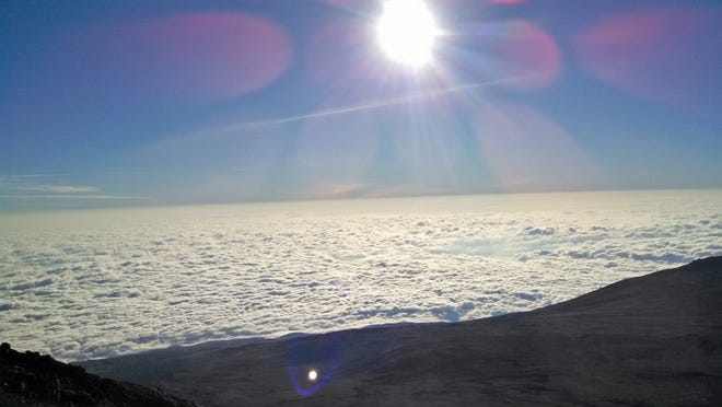 CONTRIBUTED PHOTO A view of sunrise above clouds near the top of Mount Kilimanjaro in Tanzania, East Africa.