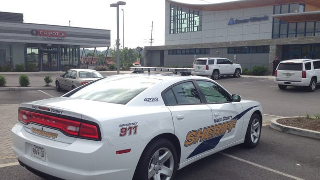 A Knox County Sheriff's Office cruiser is parked at the SmartBank on Tuesday off Cedar Bluff Road. (ADAM LAU/NEWS SENTINEL)