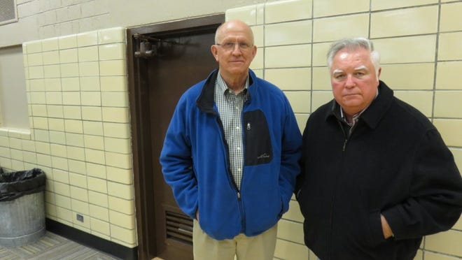 South High School graduates Bill Young, left, and Jack Jones are pictured at their old school. They played in the first Knoxville high school basketball game between all-white and all-black teams when South hosted Austin High School on Nov. 21, 1964. (John Shearer/Special to the News Sentinel)