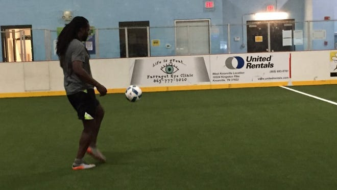 Rico Carter warms up for a game of indoor soccer on turf specially formulated for Cool Sports in West Knoxville.
