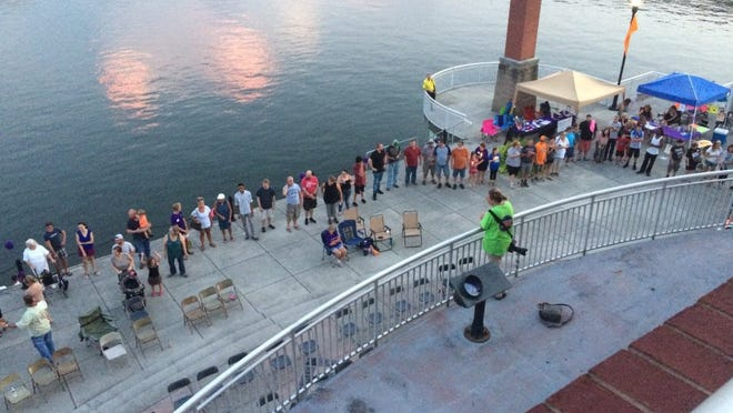 Around 200 people, many of them addicts in recovery or people who lost loved ones to addiction, took part in an awareness event and candlelight vigil in 2016 at Volunteer Landing.