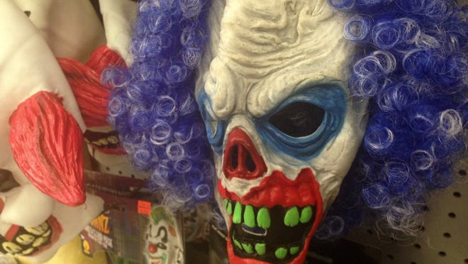 Police arrested a man after he was seen wearing a Halloween mask and carrying a sharp rod.