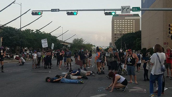 About 50 people demonstrated in front of Austin police headquarters on Tuesday, the twelfth consecutive day of protests against police violence and racism.