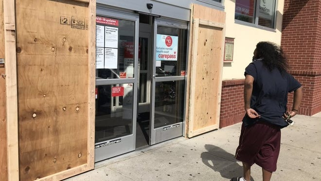 The CVS Pharmacy on Belmont Street is boarded up in Brockton ahead of a planned protest at West Middle School, Tuesday, June 2, 2020. Organizers Deja McCottrell and Ollie Spears are urging attendees to remain peaceful as other protests in Massachusetts and throughout the country have turned violent, typically in the night hours after peaceful demonstrations took place, resulting in rioting and looting.