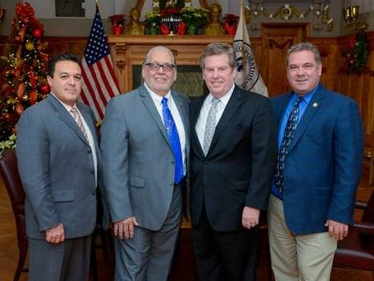 Yonkers Board of Education President Steve Lopez, second from the left, stands with other school leaders and the president of the Yonkers Chamber of Commerce.