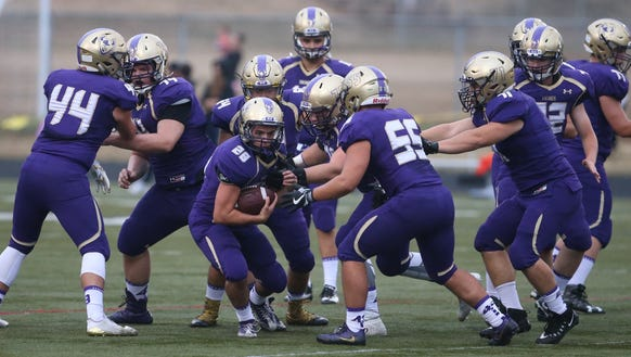 North Kitsap warms up before Friday's game against
