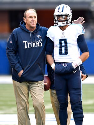 Titans head coach Mike Mularkey pats quarterback Marcus Mariota (8) on the shoulder before the game at Lucas Oil Stadium Sunday, Nov. 26, 2017 in Indianapolis, Ind.