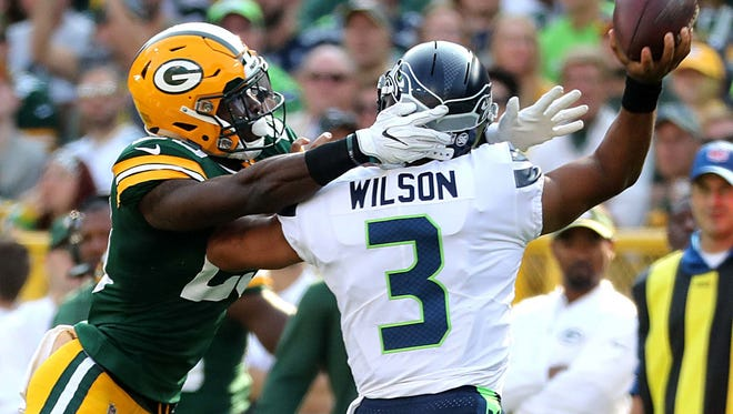 Green Bay Packers defensive back Kentrell Brice (29) pressures Seattle Seahawks quarterback Russell Wilson (3) during their game Sunday, Sept. 10, 2017.