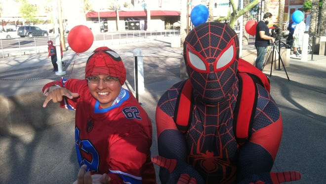 Peter Vincent (right, with friend Angeo Torrez, 40) was disqualified for not being in red and blue, but instead in the black uniform of Marvel character Miles Morales.