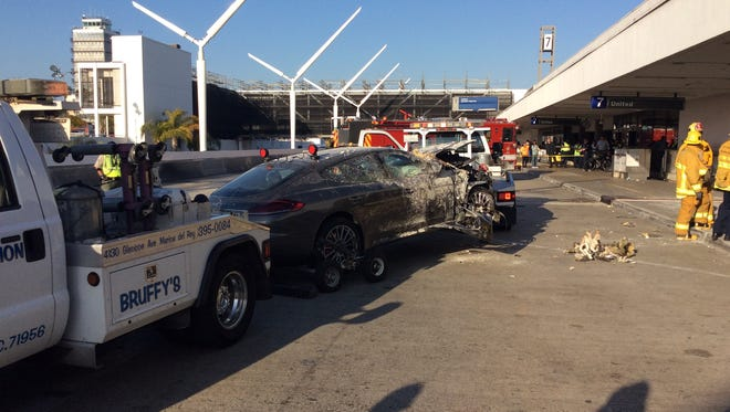 Three people were hurt, including a 9-year-old girl, when a car crashed into Los Angeles International Airport on Sunday.