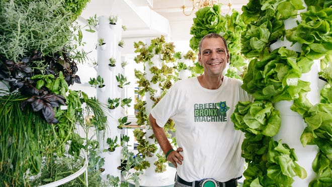Stephen Ritz is surrounded by tower gardens in his South Bronx classroom. Ritz will speak about sustainable community gardening and its power to transform education Thursday in Cherry Hill.