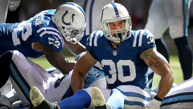 Indianapolis Colts safety LaRon Landry, shown here during Sunday's game following a tackle of Tennesse Titans' RB Shonn Greene, was suspended four games by the NFL Monday for violating the league's performance enhancing drug policy.