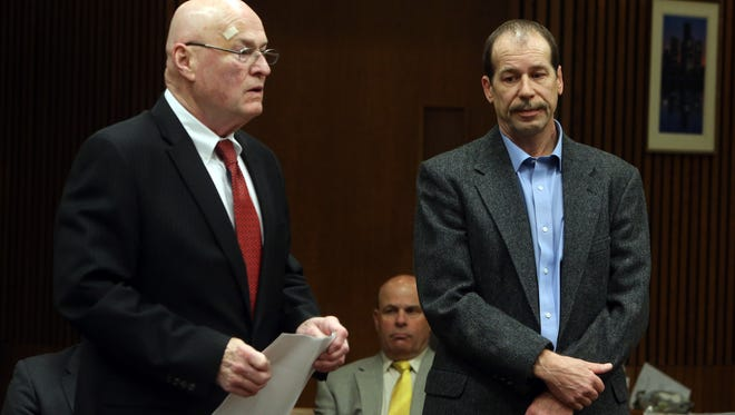 Defense lawyer Matt Carpenter, left, talks as his defendant Theodore Wafer listens during a motion hearing in Judge Timothy Kenny's courtroom inside the Frank Murphy Hall of Justice in Detroit on Friday, April 25, 2014.  Wafer is accused of fatal shooting 19-year-old Renisha McBride on the porch of his home in Dearborn Heights, Mich., in November.
