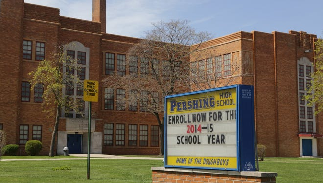 A teacher at Pershing High School in Detroit was fired May 6, 2014 after trying to break up a fight in a freshman classroom by hitting the students with a broom after she couldn't radio security.