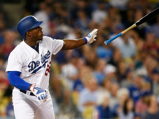 Los Angeles Dodgers' Yasiel Puig tosses his bat after hitting a solo home run against the Minnesota Twins during the fifth inning of a baseball game in Los Angeles, Wednesday, July 26, 2017. (AP Photo/Kelvin Kuo)