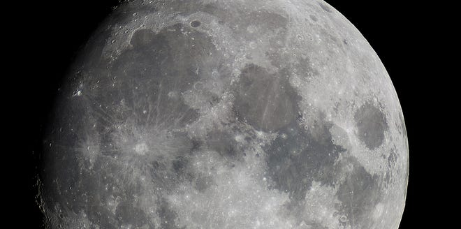 The moon is photographed by the 8-inch telescope at Chabot Space and Science Center in Oakland.