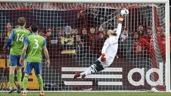 Seattle Sounders goalkeeper Stefan Frei leaps to make a save on a header from Toronto FC forward Jozy Altidore during extra time in the 2016 MLS Cup at BMO Field.