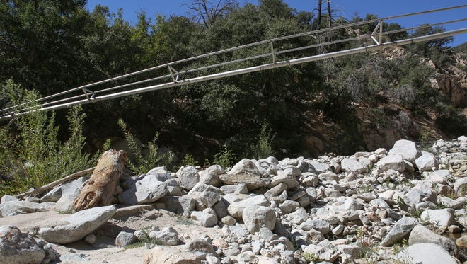 Nestle's pipeline transports water harvested from higher elevations to their collection point down the mountain. The pipeline is adjacent to Strawberry Creek, bottom, in the San Bernardino National Forest, October 11, 2017.
